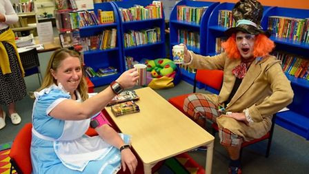 Alice and the Mad Hatter take a welcome break at Elmswell. Picture: SUFFOLK LIBRARIES