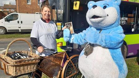 Bookstart bear hands over to Ryan Insurance in Chantry. Picture: SUFFOLK LIBRARIES