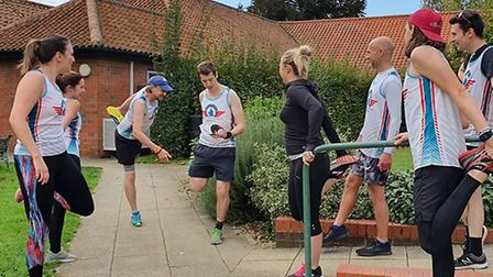 The Flying Elephant runners limber up for the Wickham Market handover. Picture: SUFFOLK LIBRARIES