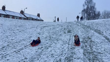 Sledging at the 'dip' next to West Suffolk College in Bury St Edmunds. Picture: MICHAEL STEWARD