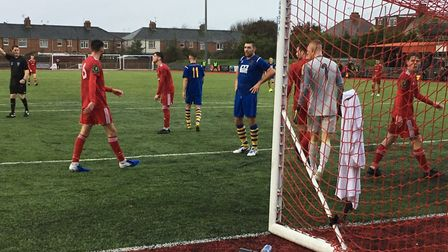FA Trophy action: Sean Marks (blue shirt) has his hands on his hips after narrowly failing to score,
