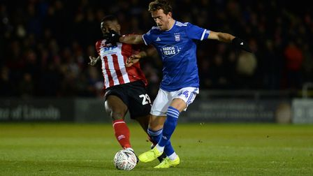 Emyr Huws under pressure at Lincoln Picture Pagepix