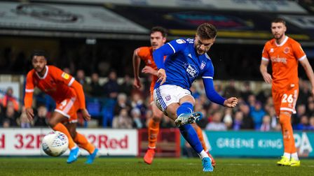 Luke Garbutt fires the Blues level against Blackpool from the penalty spot.Terry Hunt says he shou