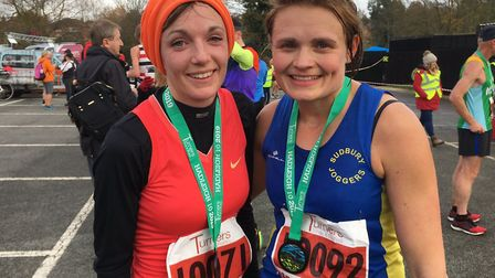 Kate Creak, left, and Emma Drury at the finish to the Hadleigh 10-mile road race. Drury won the titl