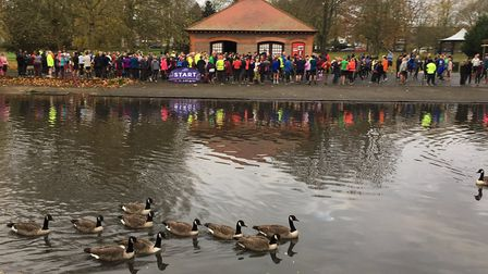 Runners and walkers congregate for the start of last Saturday's Luton Wardown parkrun, with the lake