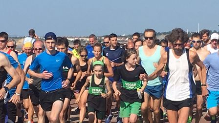 Runners set off at the start of the Hastings parkrun, on the East Sussex coast