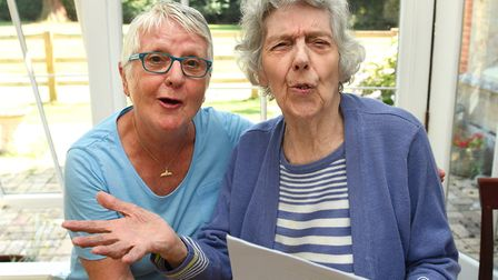 Volunteer Cheryl Gray encourages Glebe House resident Helen Daly to sing her heart out with the Comb