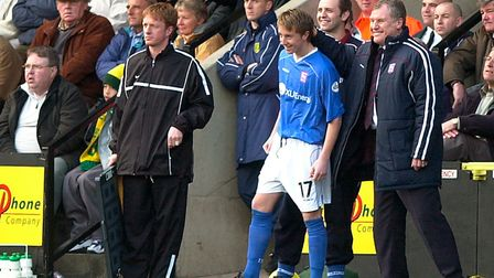 Young debut maker Dean Bowditch gets an encouraging pat on the head from manager Joe Royle as he is