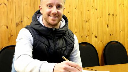 Dean Bowditch puts pen to paper to sign up for Stowmarket Town until the end of the season. Picture:
