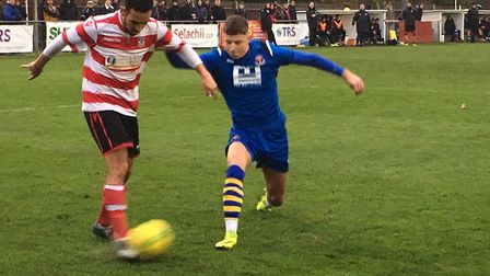 AFC left-back Baris Altintop is quick to close down Kingstonian winger Dan Bennett. Picture: CARL MA