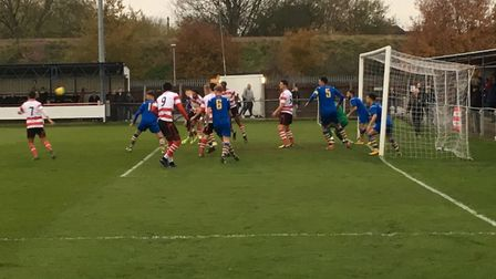 AFC Sudbury, all-blue, are on the defensive during the opening exchanges at KIngstsonian, in an FA T