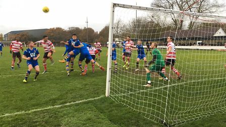 Goalmouth action as AFc Sudbury deal with another cross pumped into their box. Picture: CARL MARSTON