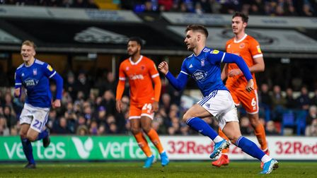 Luke Garbutt wheels away after levelling for Town from the penalty spot.Picture: Steve Waller