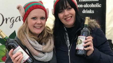 Stall holders get festive on day three of the Bury St Edmunds Christmas Fayre 2019. Picture: Lauren