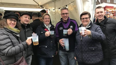 A group of friends enjoy a drink at day three of the Bury St Edmunds Christmas Fayre 2019. Picture: