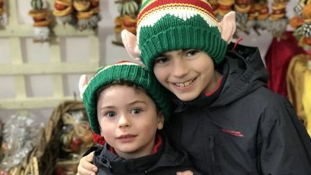 Siblings snuggle up with their festive accesories on day three of the Bury St Edmunds Christmas Fayr