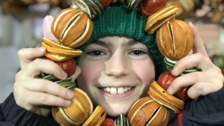 A young boy enjoys the festivites on day three of the Bury St Edmunds Christmas Fayre 2019. Picture: