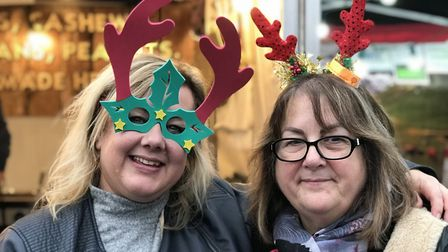 Friends show off their festive accesories on day three of the Bury St Edmunds Christmas Fayre 2019.