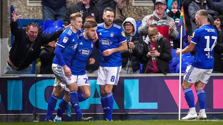Luke Garbutt is congratulated by teammates Flynn Downes and Cole Skuse after scoring from the penalt
