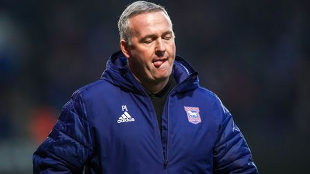 Town manager Paul Lambert heads back to the dressing room at half-time.Picture: Steve Waller w