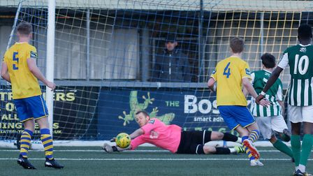 AFC Sudbury keeper Paul Walker keeps out a strike from Great Wakering's Jacob Wiggins, during a leag