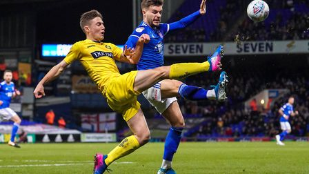 Luke Garbutt picked up a yellow card for a foul on David Wheeler as they both battled for the ball.