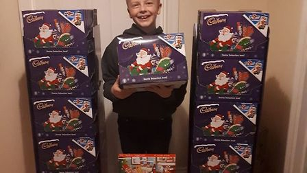 Blake with the donation of more than 100 boxes from QD Stores in Sudbury Picture: LIBBY LEONARD