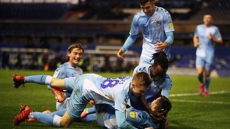 Coventry City's Liam Walsh celebrates with team-mates after scoring. Photo: PA