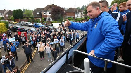 Coventry City manager Mark Robins enjoys the League Two promotion parade. Photo: PA