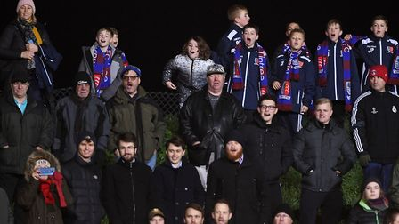 Maldon & Tiptree fans watch the action during the FA Cup second round tie against Newport, which the