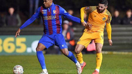 Maldon & Tiptree's Tyrique Hyde and Newport County's Padraig Amond battle for the ball during the FA