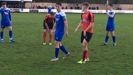 Bury Town left-back Tommy Smith keeps a close eye on Coggeshall's Robert Harvey. Picture: CARL MARST