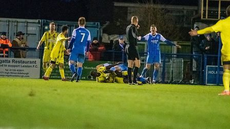 Leiston appeal for a free kick with the referee Photo: HANNAH PARNELL
