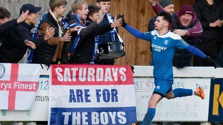 Cemal Ramadan celebrates with Bury Town fans after putting the Blues 1-0 up, against Coggeshall Town