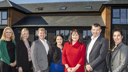Barbara Heslop (third right in red) with Ashtons Legal's Matthew Cameron (second right) and others f