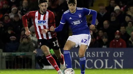 Brett McGavin in action during Town's 1-0 win over Lincoln City in the FA Cup first round replay Pho