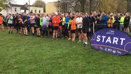 A field of 400-plus runners and walkers congregate for the start of last Saturday's Great Lines park