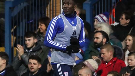 Toto Nsiala warming up during Town's 0-0 draw with Wycombe at Portman Road Photo: ROSS HALLS