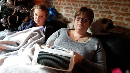 Claire Wright and her family have been left bundled under blankets after the boiler in their council