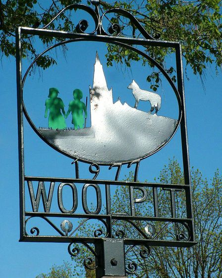 WARM WELCOME: The Woolpit village sign