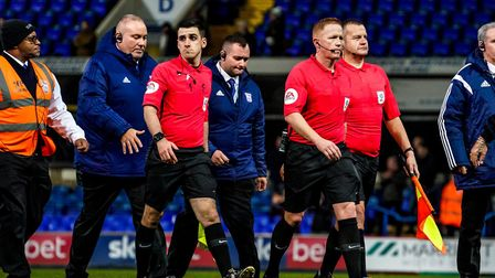 Referee Alan Young (centre) and his assistants Gareth Viccars (right) and Aaron Farmer (left) surrou