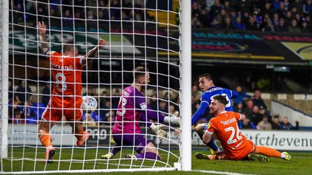 Jay Spearing clears off the line for Blackpool - but did the ball cross? Photo: Steve Waller