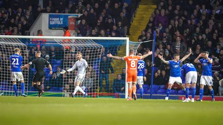 Ipswich Town players appeal as referee Stephen Martin awards Blackpool a penalty at Portman Road. Ph