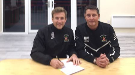 Dan Morphew, left, signs his new contract at Needham Market on Thursday evening, alongside manager R