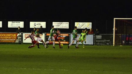 Jack Newman slots home Felixstowe and Walton United's second goal, to put them 2-0 up, although they