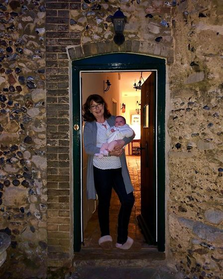 Mark's wife Carol Cordell and their grandaughter Florence, now 13 months old, in the doorway of thei