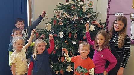 The children at Easton PrimarySchool in Woodbridge with their eco-friendly tree made from recycled m