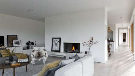 Can you imagine relaxing in front of the cozy wood burning stove? Picture: FOTOFRANCH