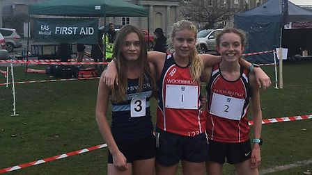 Top three finishers in the intermediate girls' event, from left: Tilly Aldis, April Hill (winner) an