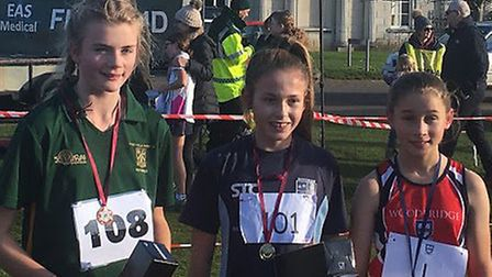 Top three in the minor girls' race, from left: Izzy Last, Bella Taylor (winner) and Rose Jackson. Pi